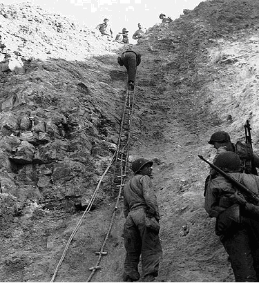 US Rangers demonstrating the rope ladders used to storm the Cliffs at Pointe du Hoc.