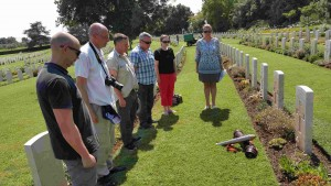 members of 209 (Manchester) Battery pay respects to a Manchester Gunner in Sangro War Cemetery