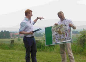 Overlooking Lutter-am-Barenberg, two officers give their terrain analysis of the Hainberg feature north of the Harz mountains