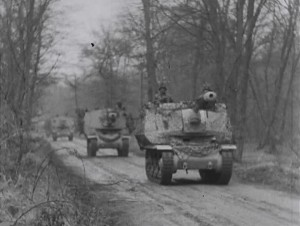 Sp Guns 21 Panzer Division advancing along road